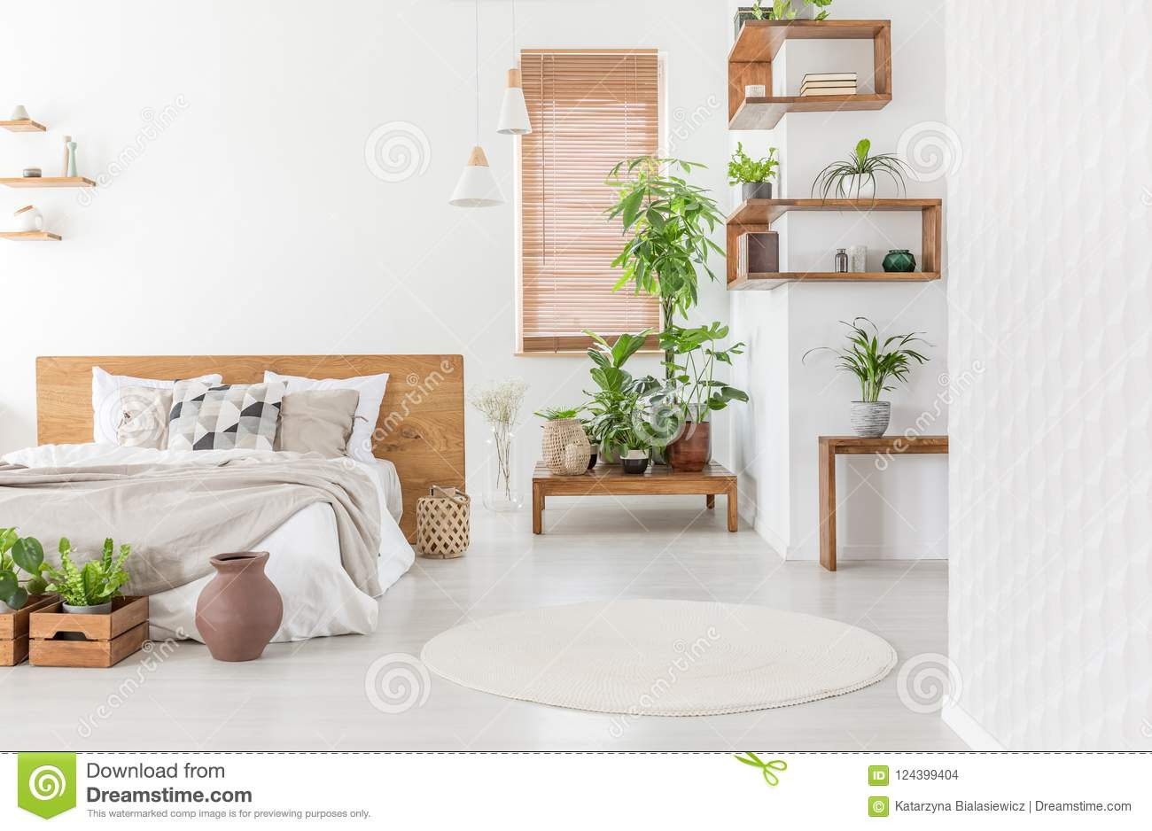 master bedroom hardwood floors of real photo of a cozy bedroom interior with plants double bed r with real photo of a cozy bedroom interior with plants double bed round rug and wooden accents concept