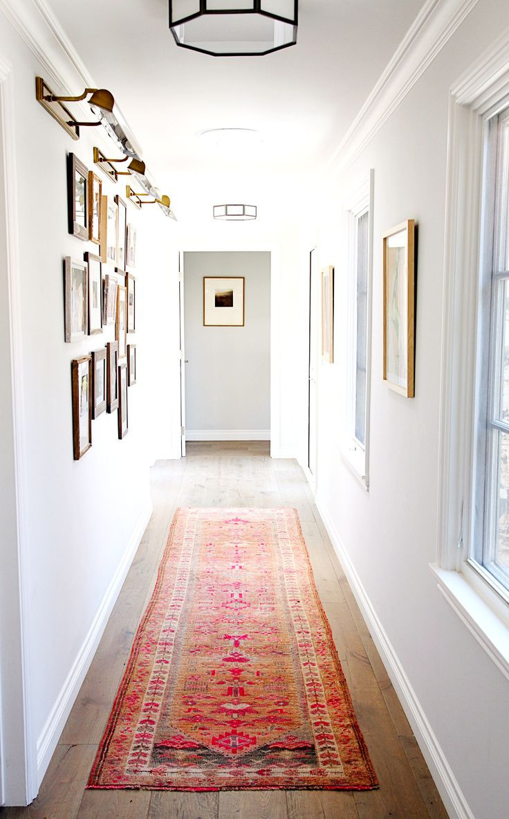 pictures of hardwood floors in hallways of 1480 best h o m e interiors images on pinterest family rooms with regard to hallway with white walls framed artwork wood floors and bright patterned rug