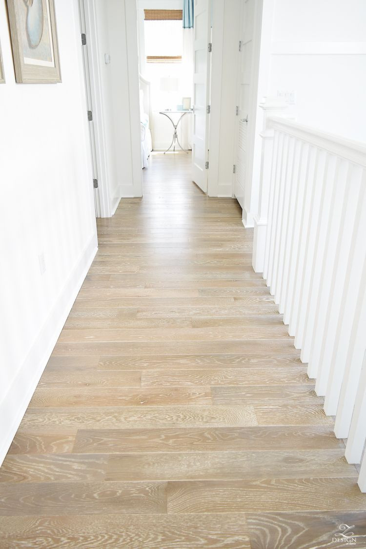 Pictures Of Hardwood Floors In Hallways Of Grid Wall Pattern In Staircase with White Walls Blonde Distressed with Grid Wall Pattern In Staircase with White Walls Blonde Distressed Hardwood Floors Chrome Coastal Chandelier Beach House Design Coastal House Decor How to