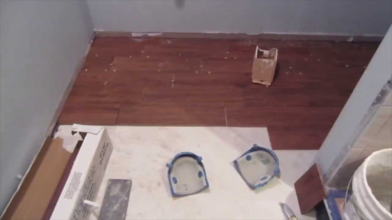 putting hardwood floor on concrete slab of how to install a wood look porcelain plank tile floor youtube throughout how to install a wood look porcelain plank tile floor