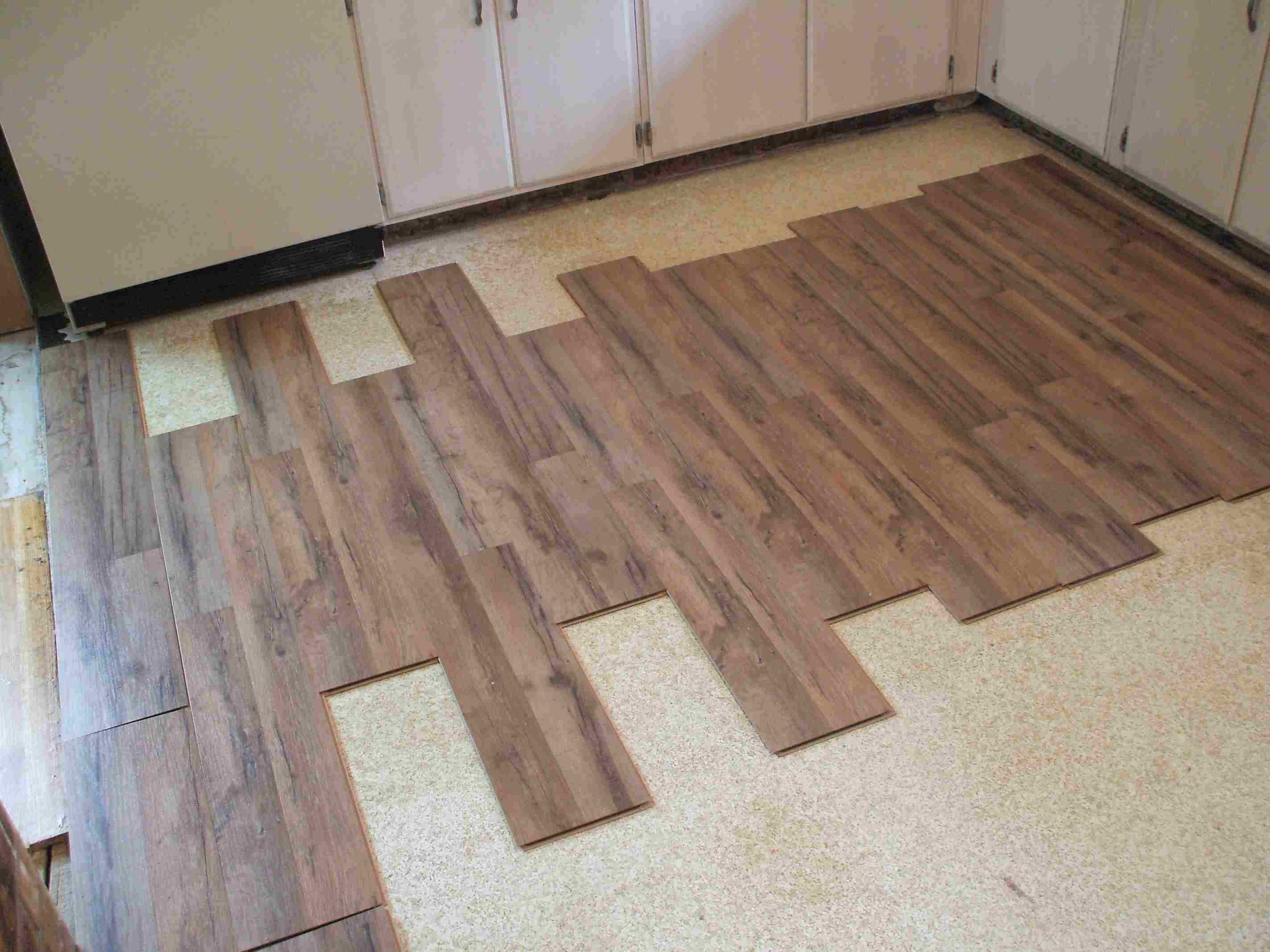 putting hardwood floors on concrete of laminate flooring installation made easy throughout installing laminate eyeballing layout 56a49d075f9b58b7d0d7d693 jpg
