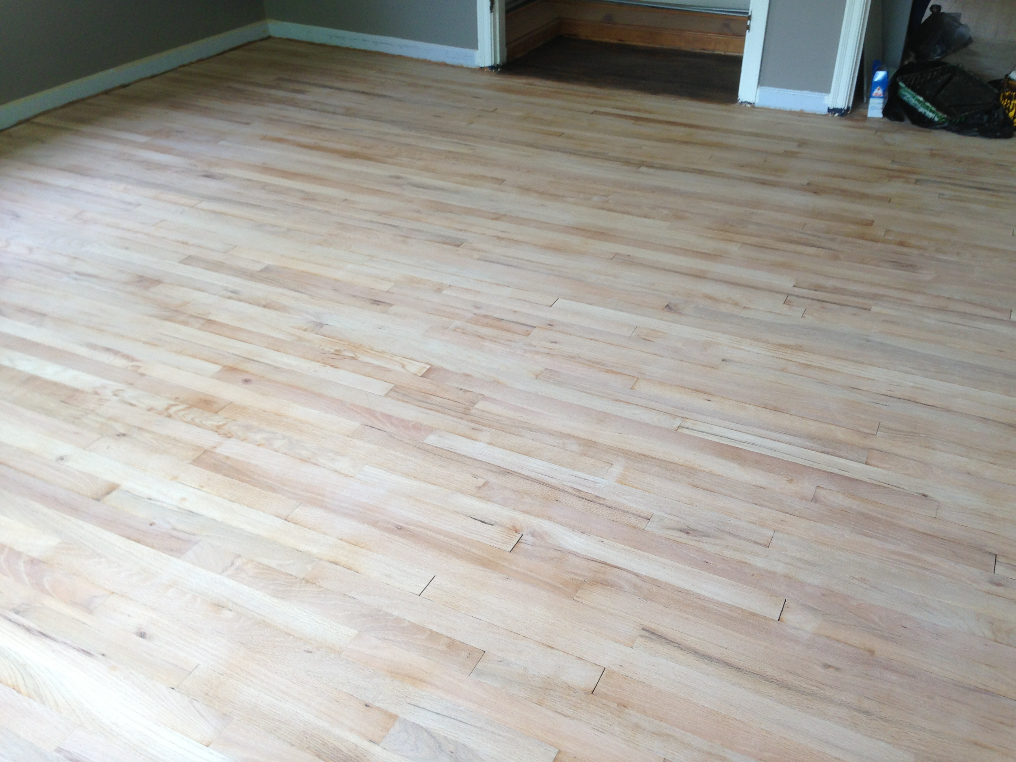 refinishing hardwood floors under carpet of hardwood floors flair within after tediously sanding the floors we were ready for the next step of staining and sealing the floors here is a picture of the floors pre staining