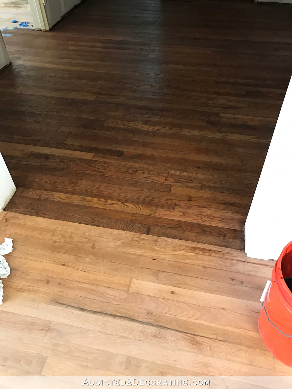 restaining hardwood floors diy of adventures in staining my red oak hardwood floors products process within staining red oak hardwood floors 2 tape off one section at a time for