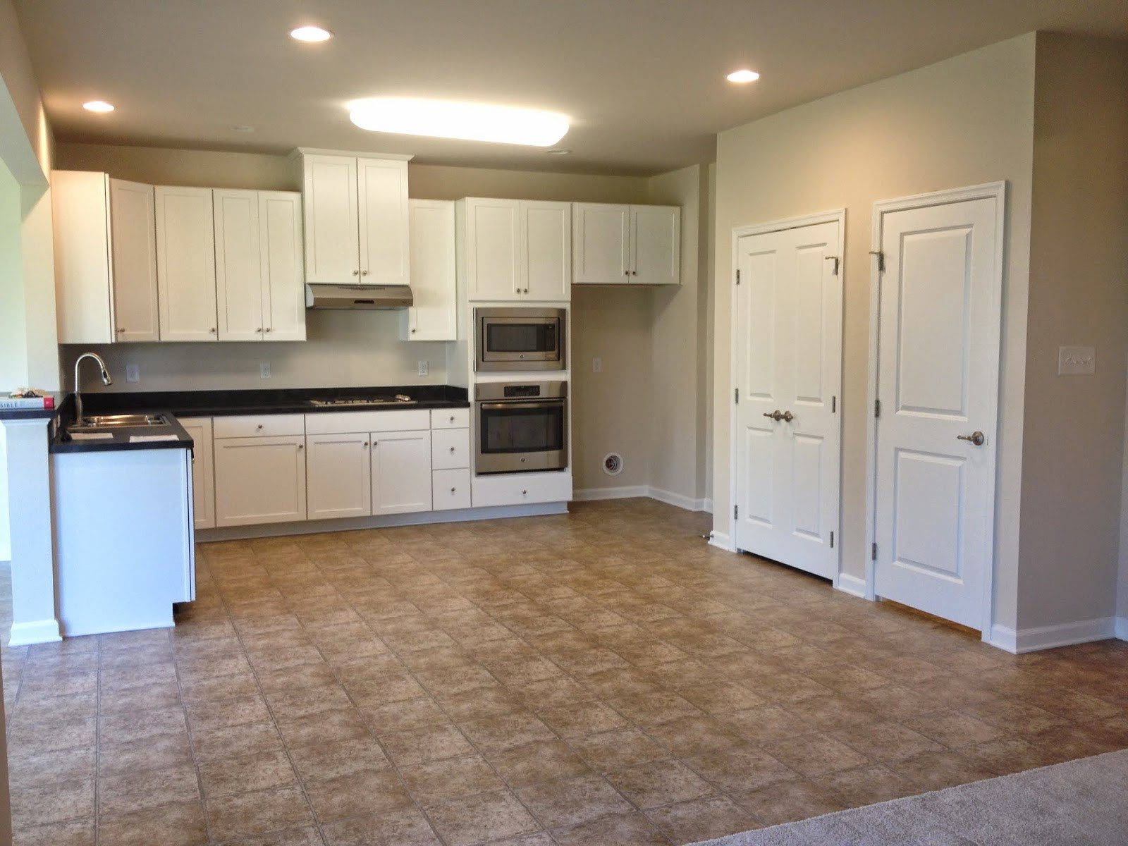 ryan homes hardwood floor options of road to palermo within kitchen showing pantry left and door to basement