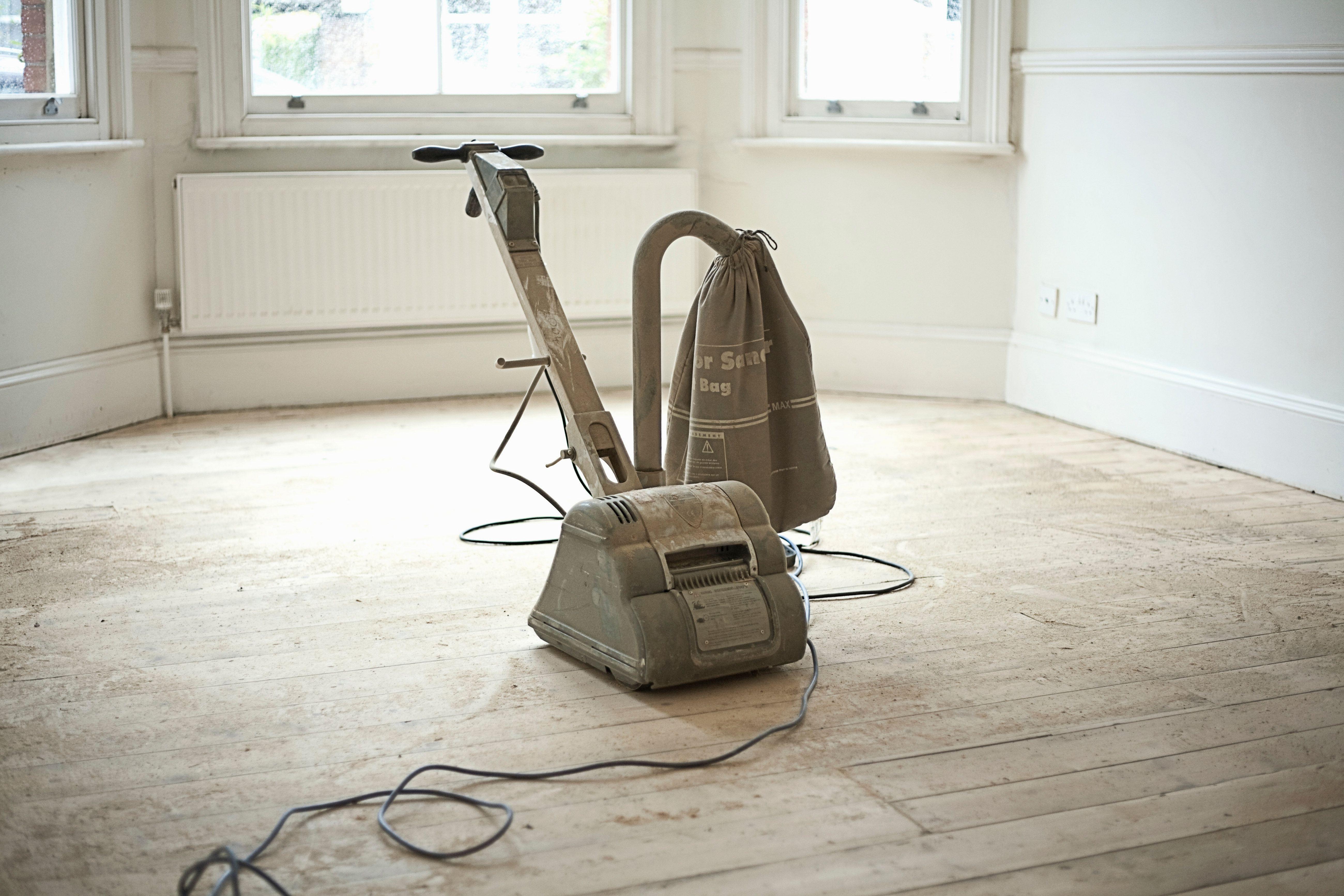 sanding and refinishing hardwood floors of floor sanders to rent when finishing your wood floor regarding sander on wooden floorboards of new home 179707189 588760815f9b58bdb3fed440