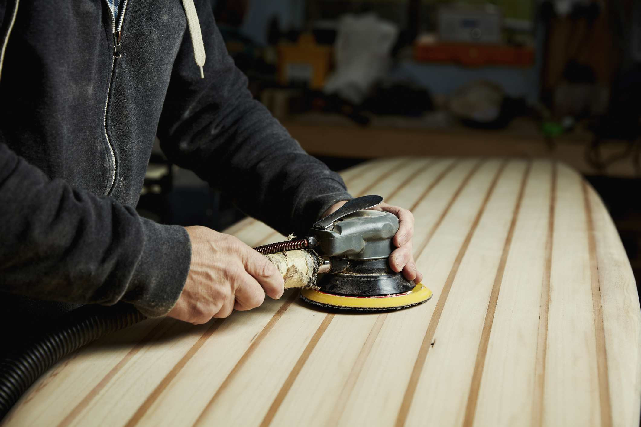 sanding hardwood floors with a hand sander of how to sand wood intended for a mans hands working with an orbital sanders