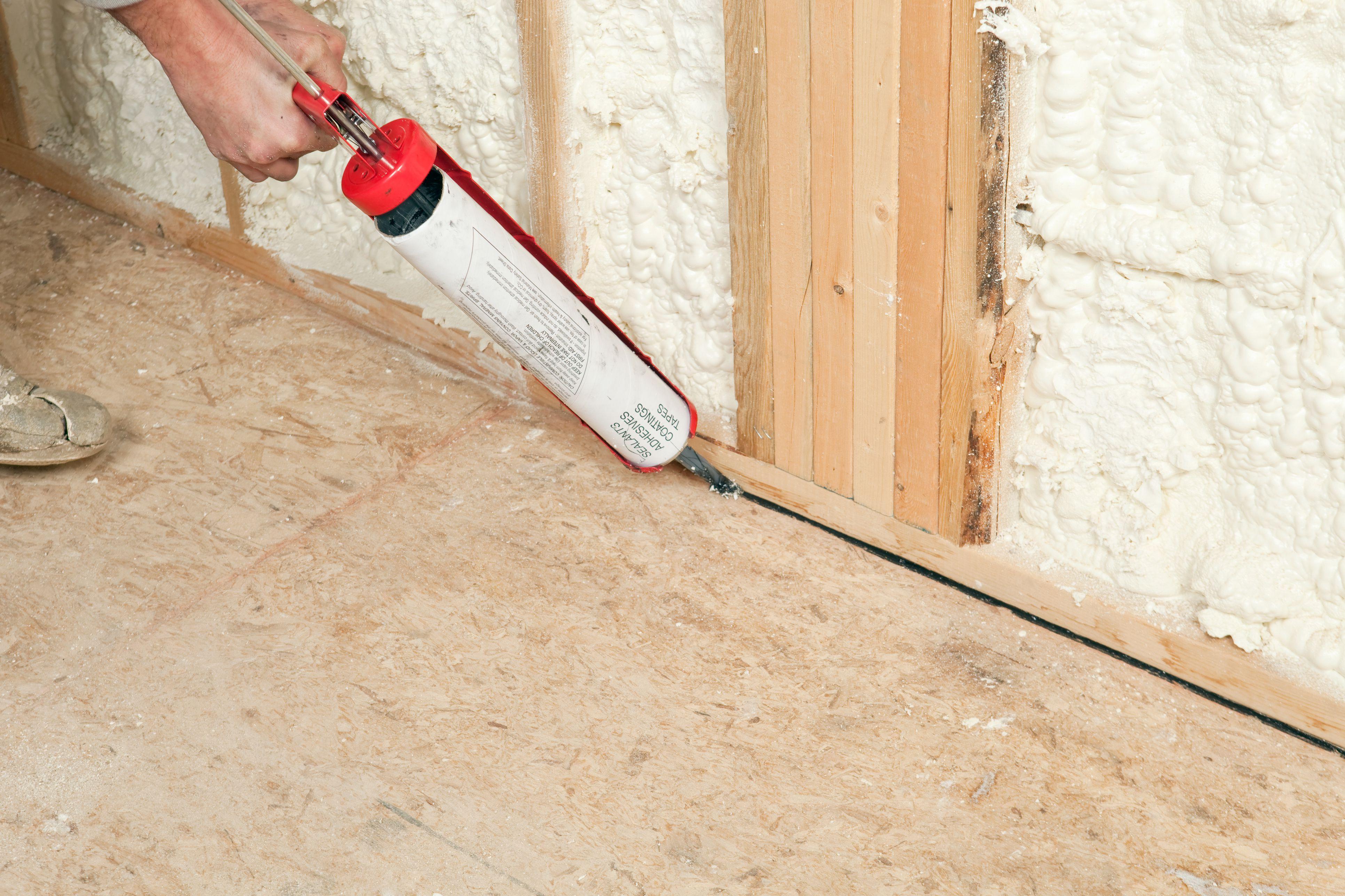 texas hardwood flooring reviews of osb oriented strand board sub flooring inside worker caulking wall plate to subfloor 185099682 57fa64803df78c690f7666e2