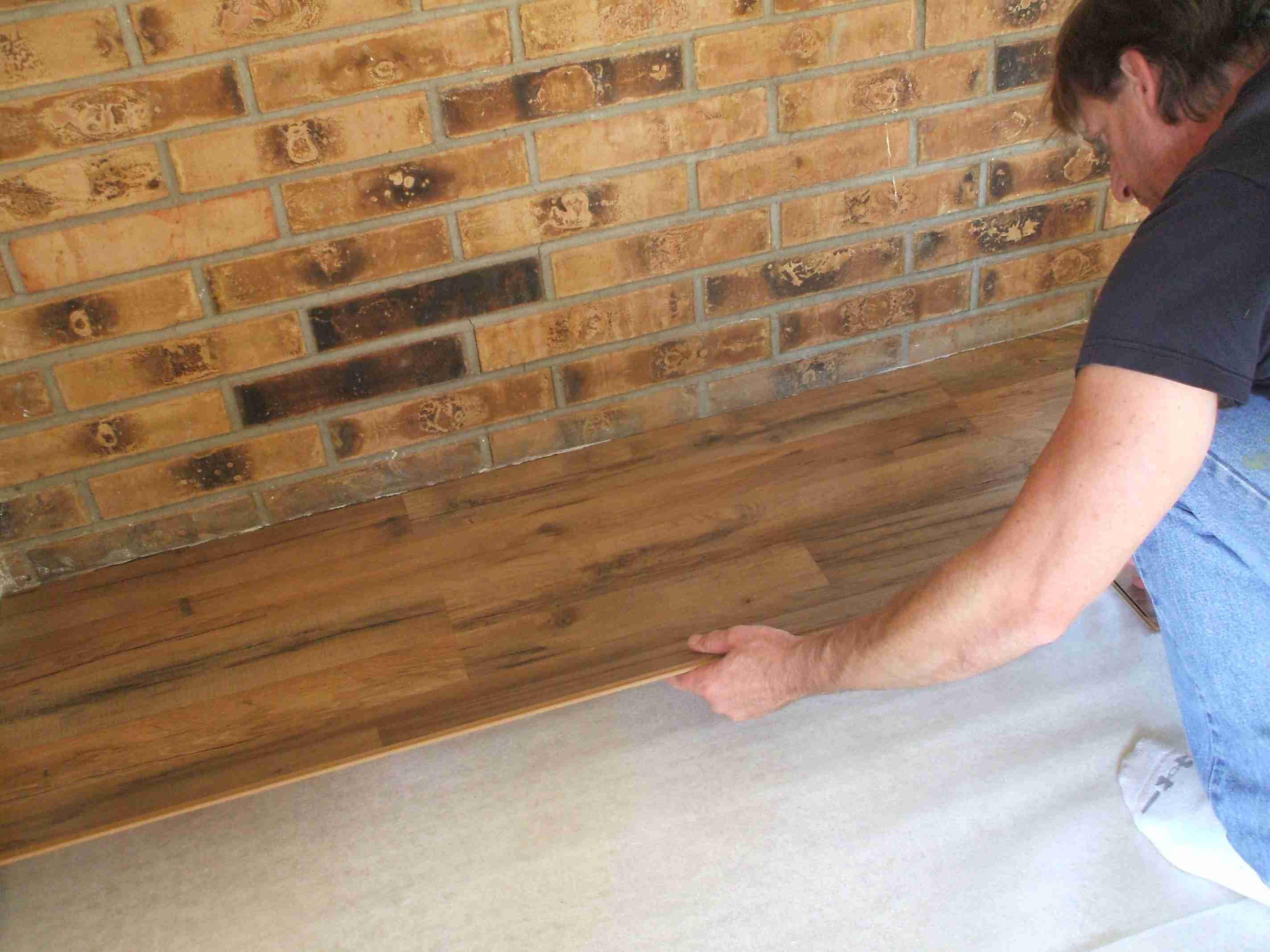 using hardwood flooring on walls of laminate flooring installation made easy inside installing laminate laying first row 56a49e425f9b58b7d0d7ddd7 jpg