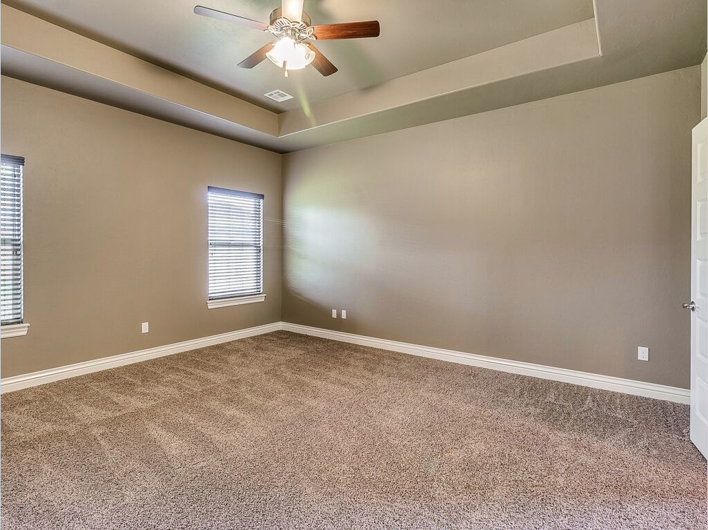 using hardwood flooring on walls of master bedroom designed with earth tones tan carpeting green walls throughout master bedroom designed with earth tones tan carpeting green walls and dark wooden ceiling fan