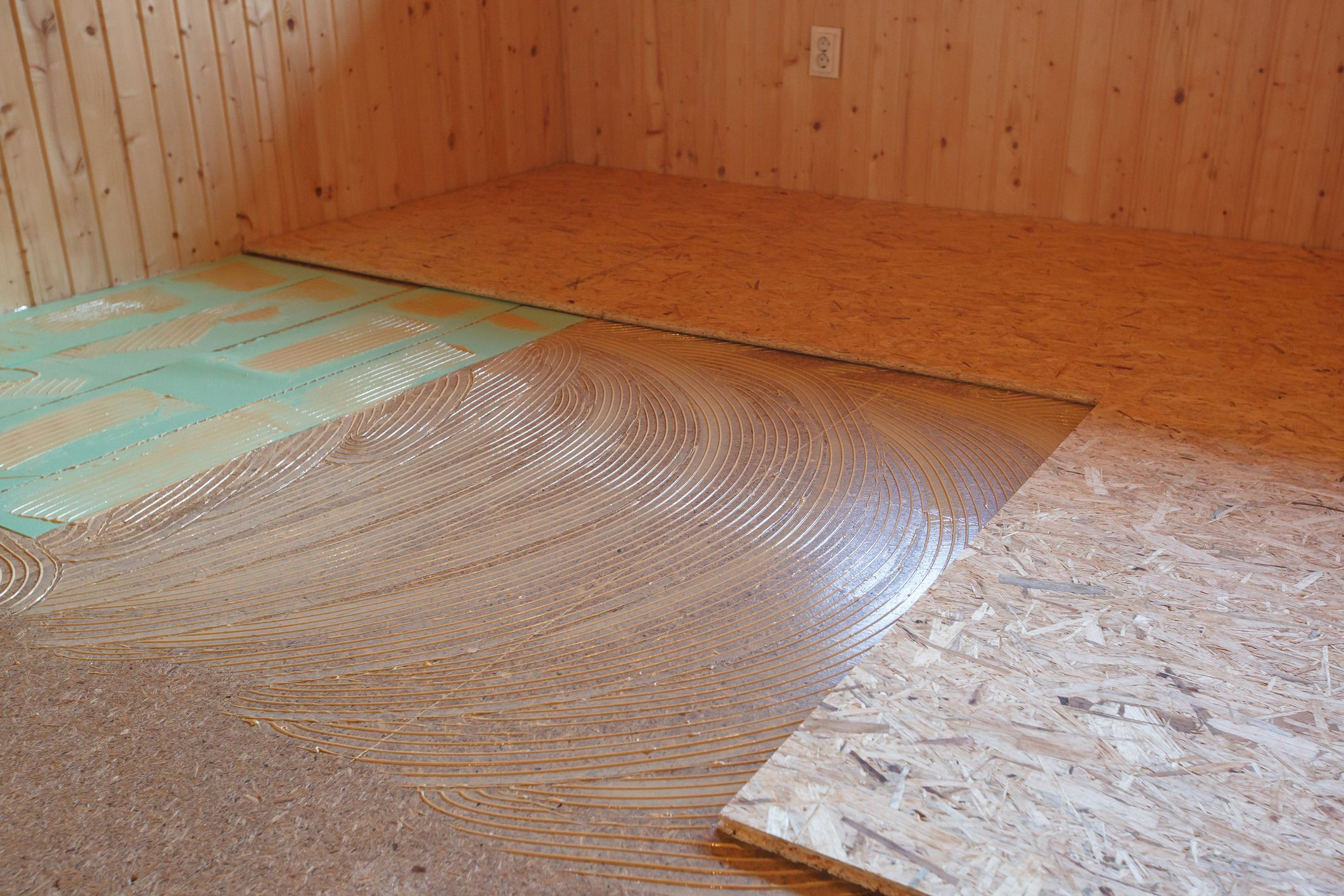 v groove hardwood flooring of types of subfloor materials in construction projects within gettyimages 892047030 5af5f46fc064710036eebd22