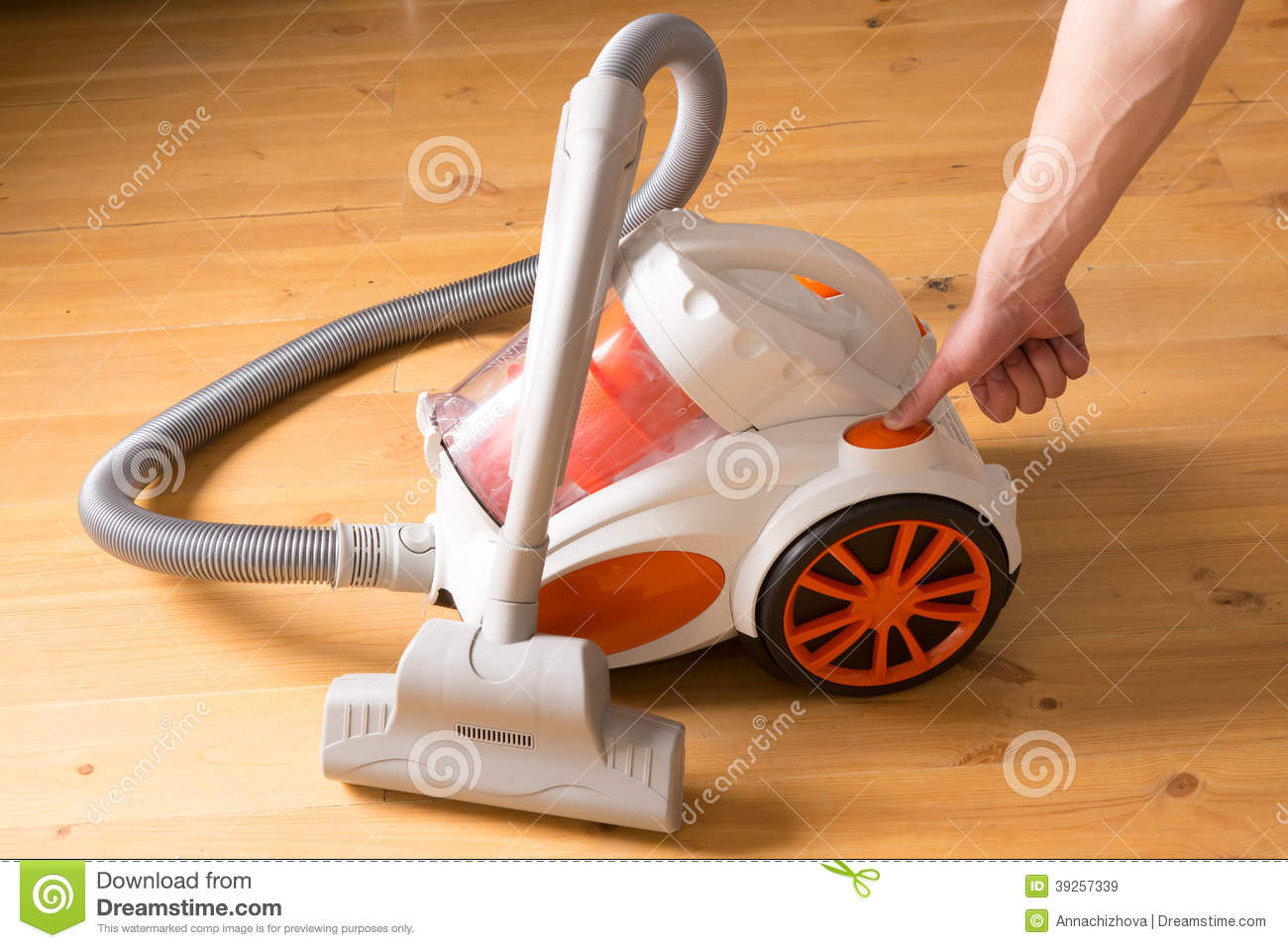 vacuum cleaner for hardwood floors of closeup of a hand to turn on the vacuum cleaner man is unrecogn with closeup of a hand to turn on the vacuum cleaner man is unrecogn