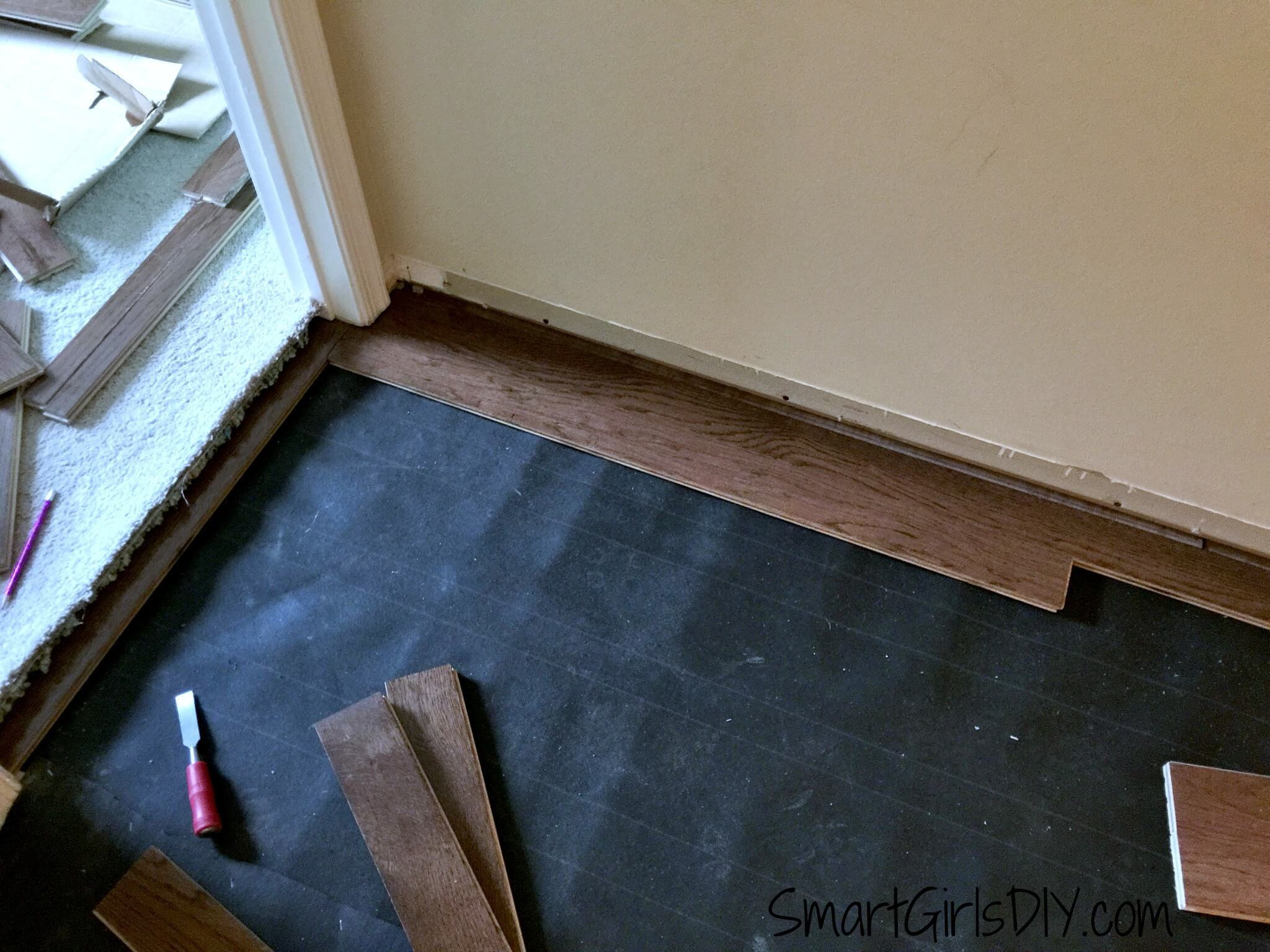 what direction should hardwood floors run of upstairs hallway 1 installing hardwood floors throughout laying out bruce hardwood flooring first and second row of bruce hardwood being installed