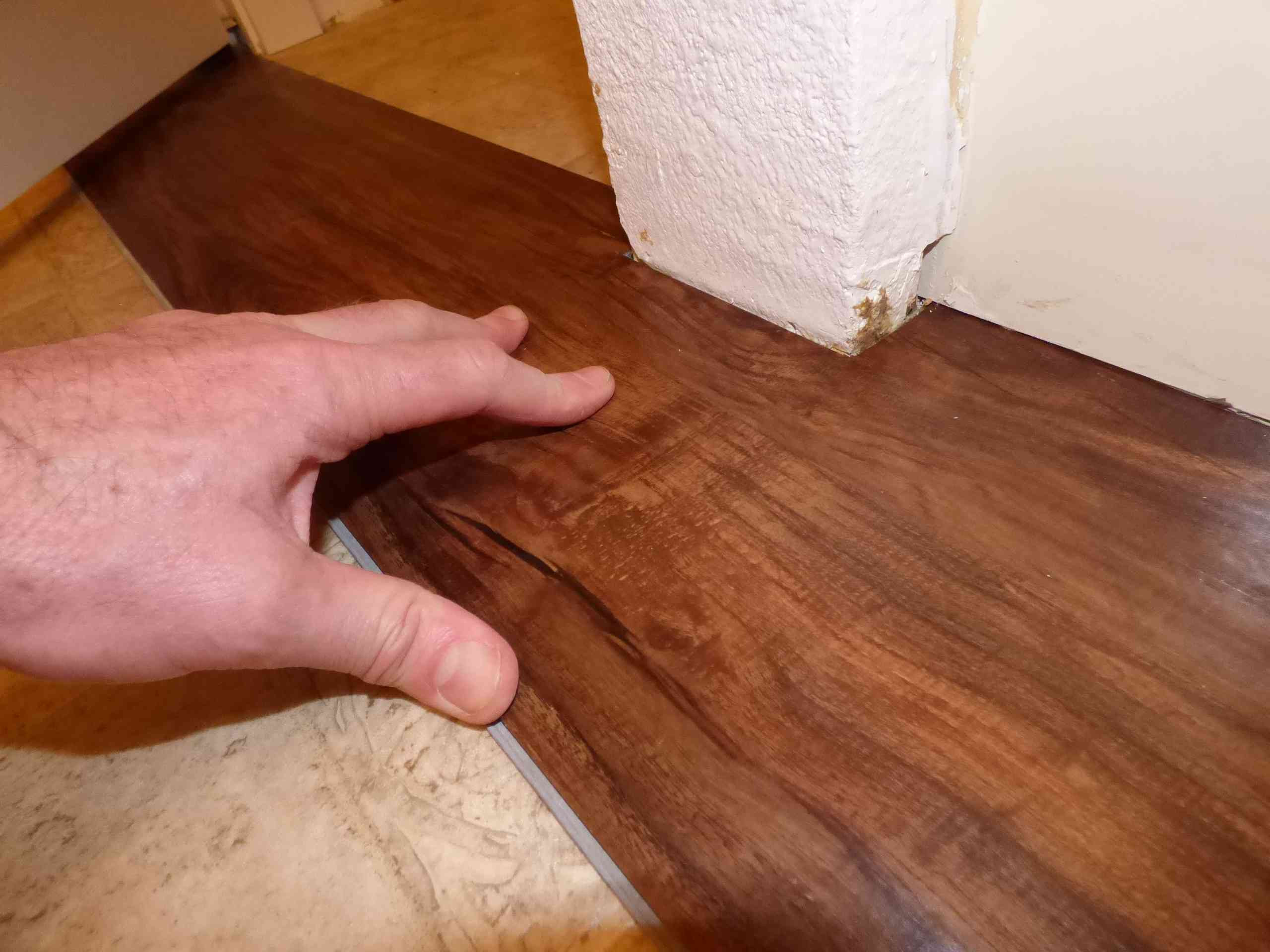 which direction should you lay hardwood floors of its easy and fast to install plank vinyl flooring with regard to fitting plank around protrusions 56a4a04f3df78cf7728350a3 jpg